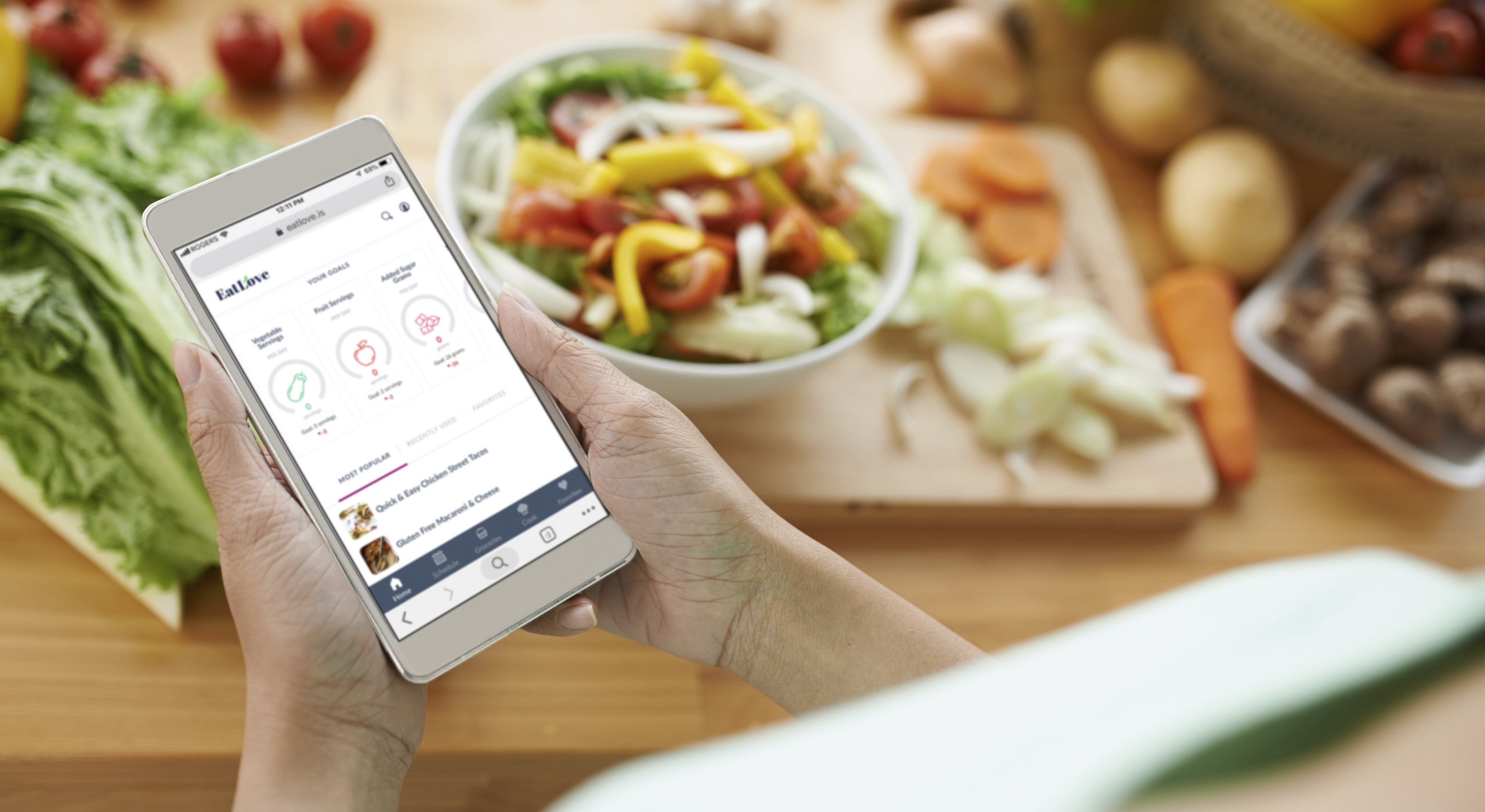 Woman using the EatLove meal planning platform